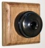 Square Single Oak Pattress with Plain Antique Brass Black Ceramic Dolly Switch