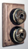 Double Oak Pattress with Plain Brass Black Ceramic Dolly Switches