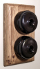 Double Oak Pattress with Plain Antique Brass Black Ceramic Dolly Switches