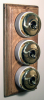 Triple Oak Pattress with Plain Brass Ivory Ceramic Dolly Switches