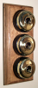 Triple Oak Pattress with Plain Brass Black Ceramic Dolly Switches