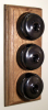 Triple Oak Pattress with Plain Antique Brass Black Ceramic Dolly Switches