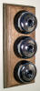Triple Oak Pattress with Plain Chrome Black Ceramic Dolly Switches