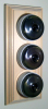 Triple Pine Pattress with Plain Antique Brass Ivory Ceramic Dolly Switches