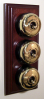 Triple Mahogany Pattress with Plain Brass Black Ceramic Dolly Switches