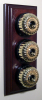 Triple Mahogany Pattress with Ribbed Brass Black Ceramic Dolly Switches