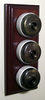 Triple Mahogany Pattress with Plain Antique Brass Ivory Ceramic Dolly Switches