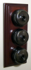 Triple Mahogany Pattress with Plain Antique Brass Black Ceramic Dolly Switches