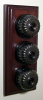 Triple Mahogany Pattress with Ribbed Antique Brass Black Ceramic Dolly Switches