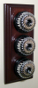 Triple Mahogany Pattress with Ribbed Chrome Black Ceramic Dolly Switches