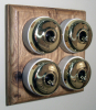 Quadruple Oak Pattress with Plain Brass Ivory Ceramic Dolly Switches