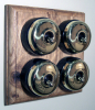 Quadruple Oak Pattress with Plain Brass Black Ceramic Dolly Switches