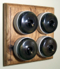 Quadruple Oak Pattress with Plain Antique Brass Ivory Ceramic Dolly Switches