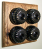 Quadruple Oak Pattress with Ribbed Antique Brass Black Ceramic Dolly Switches