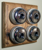 Quadruple Oak Pattress with Plain Chrome Ivory Ceramic Dolly Switches