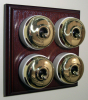 Quadruple Mahogany Pattress with Plain Brass Ivory Ceramic Dolly Switches