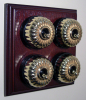 Quadruple Mahogany Pattress with Ribbed Brass Black Ceramic Dolly Switches