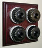Quadruple Mahogany Pattress with Ribbed Antique Brass Ivory Ceramic Dolly Switches